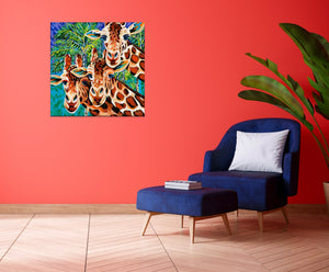 Three Giraffe friends painting in a sitting room
