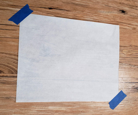 Sheet of paper taped to the floor