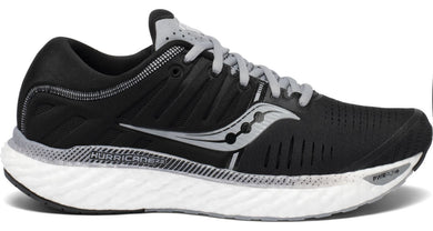 Saucony Women's Hurricane 22 Running Shoe in Black/White from the side