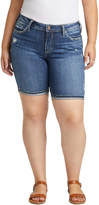 Women's Silver Jeans Plus Size Suki Curvy Fit Mid Rise Bermuda Shorts in Distressed Dark Wash from the front
