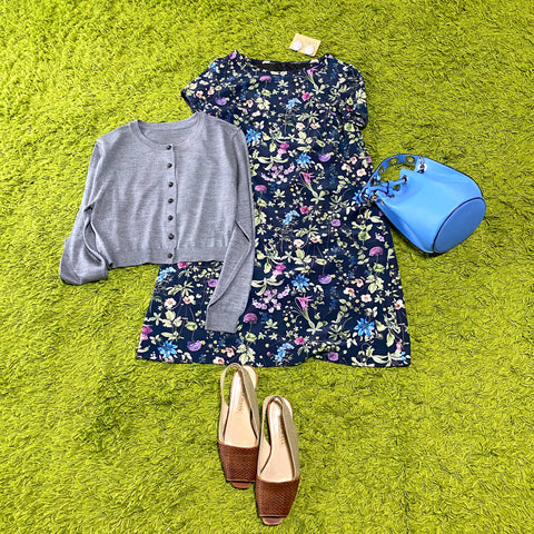 Dress with bright floral sleeves on a dark blue background