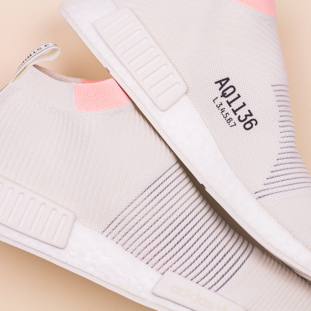 c848de80cfa3b Adidas Originals NMD CS1 PK Primeknit W Women Boost White Clear Orange  AQ1136. Price   240 CAD. Available Sizing  5-9 US Women s. Click Shop Now  when the ...