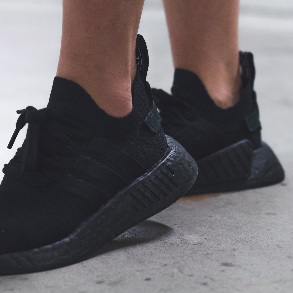 568dd7b9a877d Click here to purchase the Womens Triple-Black NMD R2 once live on our  website.