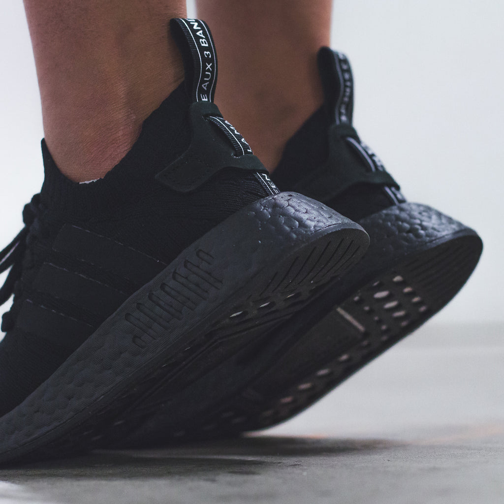 5e2a40d4c6d5a adidas nmd r2 womens triple black the new adidas yeezy shoes ...