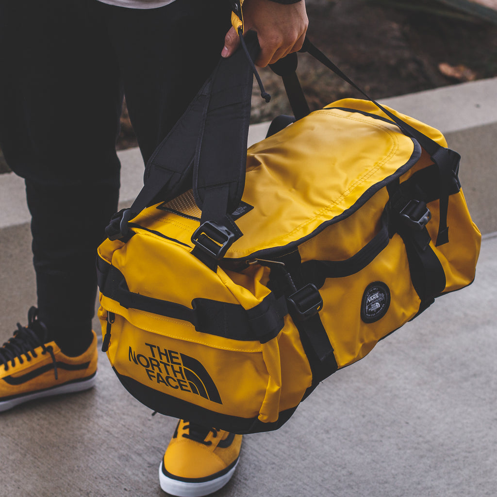 47fba9fe20 The North Face x Vans Base Camp Duffle Backpack in Triple-Black -  140 CAD  ( Link )