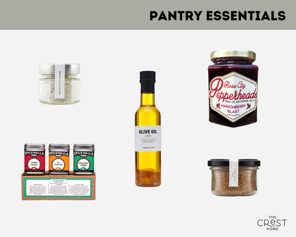 """Several good items are arranged on a light grey background. A green banner at the top reads """"Pantry Essentials"""". Pictured are a jar of salt, a trio of spices, olive oil, jam, and a jar of brown sugar."""