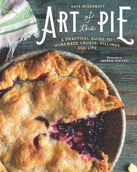 """A book cover with a top-down view of a pie with a full top and red filling. It has one slice missing, and is in a dish. It is on a blueish wooden background. In the upper right section, the cover reads """"Art of Pie""""."""