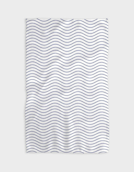 A rectangular tea towel. There are many shallow frequency waves, parallel against a white background.