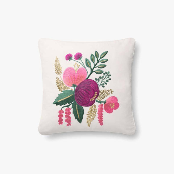 A white pillow with embroidered flowers and leaves in pink, purple, green, and gold.
