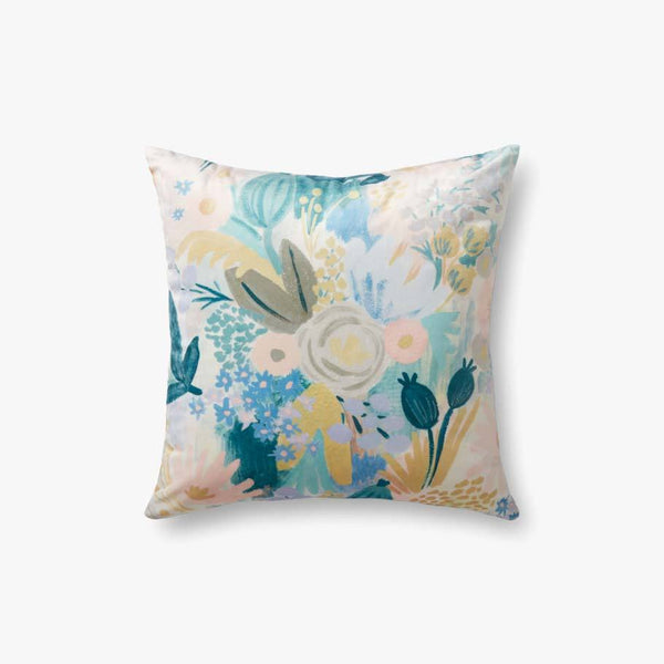 A square velvet pillow that is completely covered in a pastel-colored floral print.
