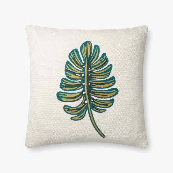 A white square pillow with a green embroidered split-leaf monstera deliciosa leaf in the center.