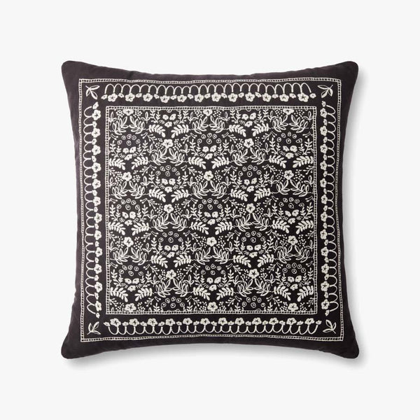A black pillow with silvery-white embroidery. A square decorative border encloses a repeating pattern of florals and leaves.