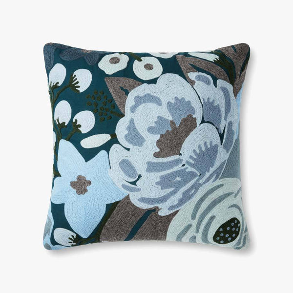 A square pillow with large crewel embroidered florals. The florals are in shades of blue with grey leaves and extend to the edge of the pillow.