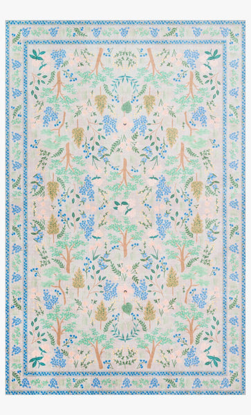 A light grey rug with a border of blue lines and botanicals. Inside the border is a symmetrical pattern with trees and botanicals rendered in light blues, greens, pinks, and brown for the trunks of the trees.