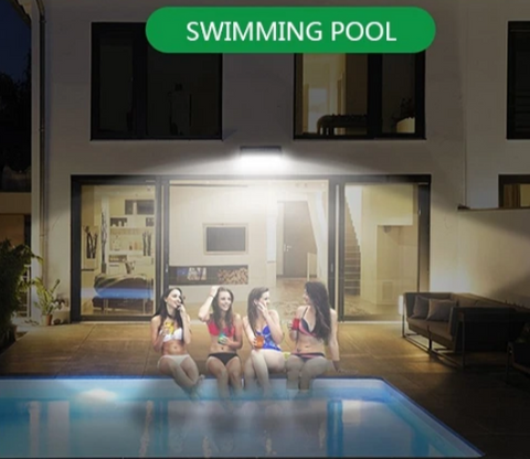 Sensor light illuminates swimming pool with four girls