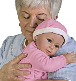 real life doll in arms of older woman