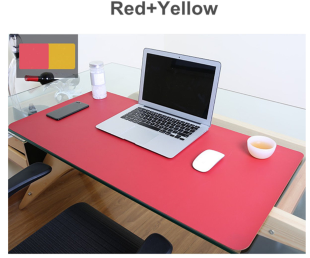 Mouse pad red on work desk with red/yellow reversible colors displayed on easel