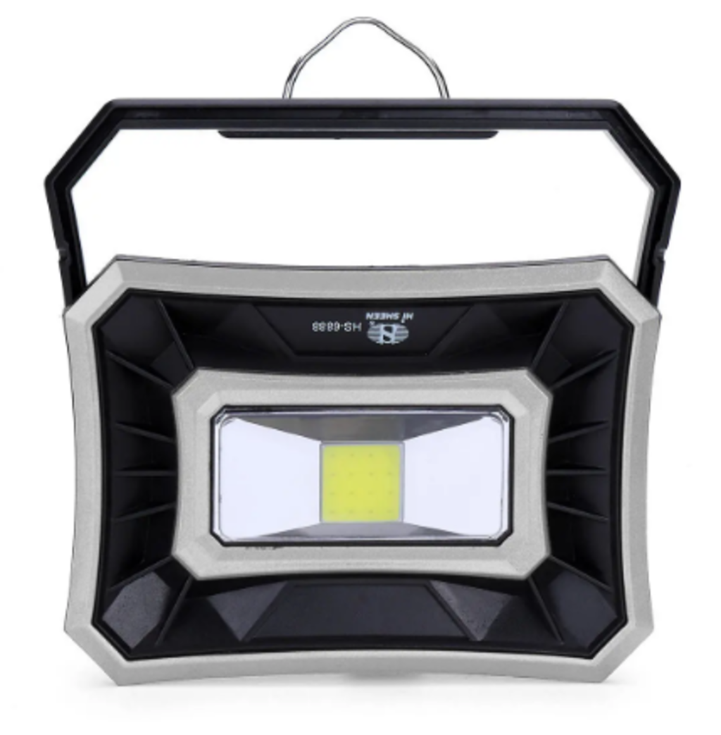 Solar camping lantern face view standing straight up on stand, subtle green depicting source light in center