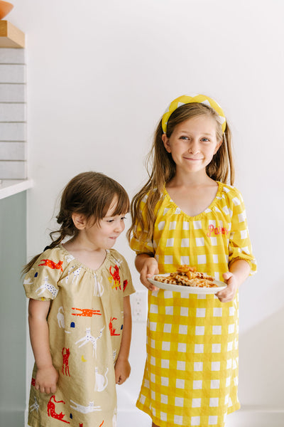 Kids holding a plate of waffles