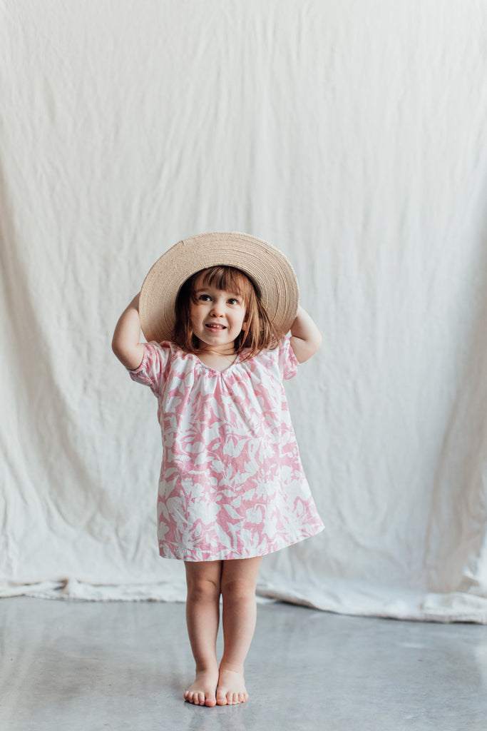 Girl's Pink Nightgown with Floral Print. Sizes 2T-3T and 6-7. Both Long Sleeve and Short Sleeve. 100% Cotton Nightgown for Toddlers and Kids. Can be Worn for Day Like This With a Straw Beach Hat.