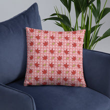 Load image into Gallery viewer, PINK AUTUMN LEAF pattern square pillow on an armchair.
