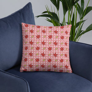 PINK AUTUMN LEAF pattern square pillow on an armchair.