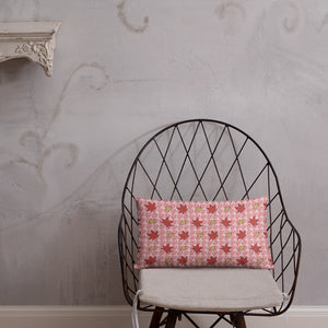 PINK AUTUMN LEAF pattern rectangular pillow on a wire chair.
