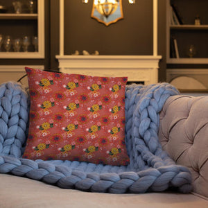Square cushion on couch with pretty autumn flower
