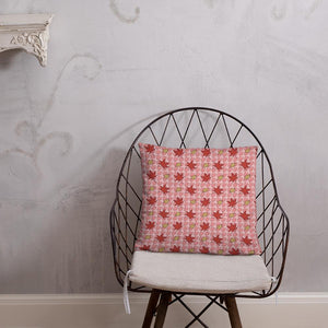 PINK AUTUMN LEAF pattern square pillow on a wire chair.