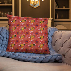 Large square cushion on couch with pretty autumn flower