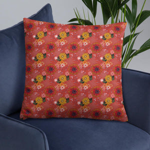 Square cushion on armchair with pretty autumn flower