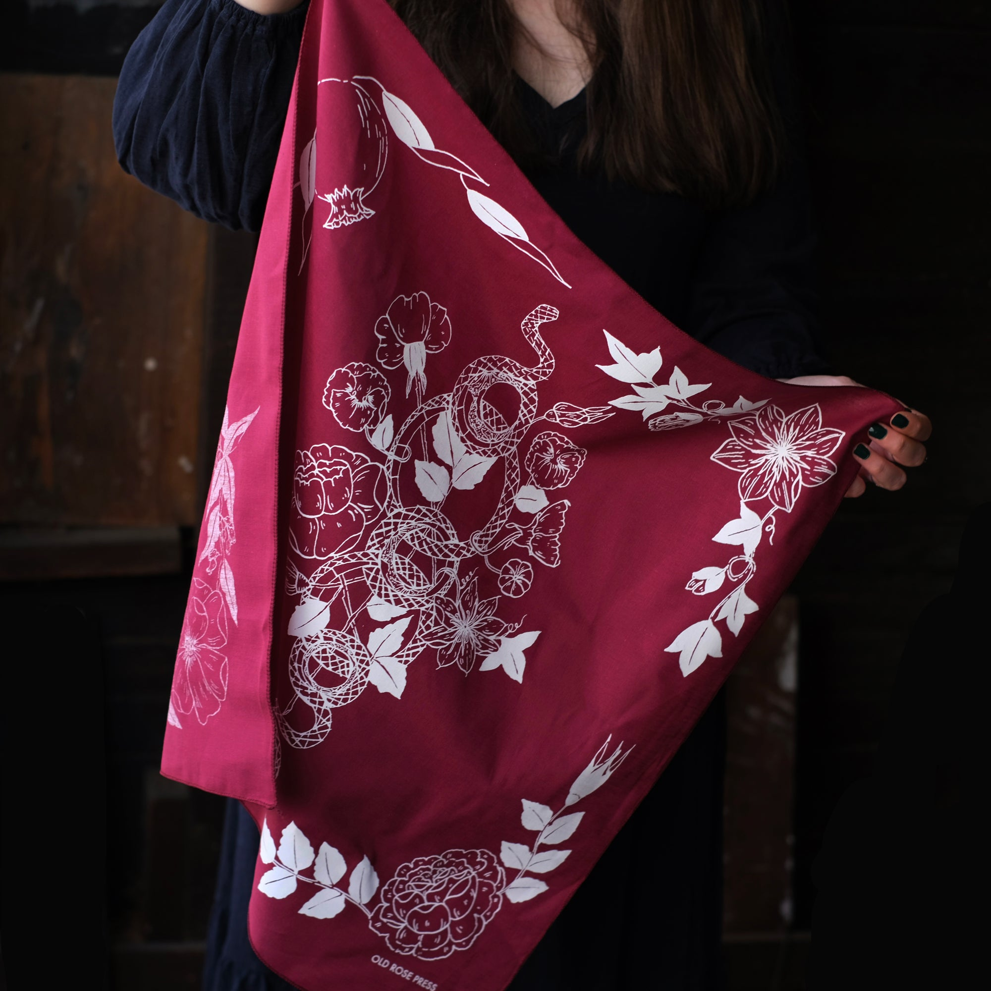 Serpent Garden Bandana reflects the botanicals throughout the four seasons, alongside a plant adorned snake. Artisan printed and illustrated by hand, to be used as an accessory or altar cloth.