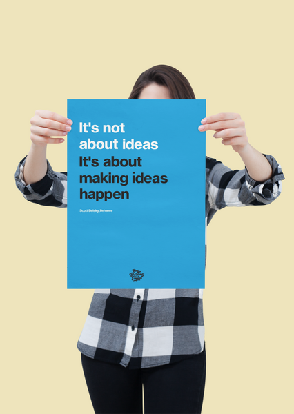 Woman holding up Scott Belsky motivation poster print