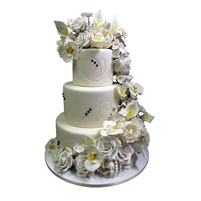 White Floral Cascading Swirl Cake
