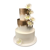 Three tiered wedding cake covered with ivory fondant hand painted edible gold and sugar-paste orchids