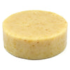 Dirty Dog round, cream white soap with yellow flecks of calendula blossom