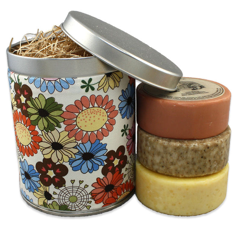 three round bar soaps in floral gift tin