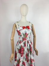 Load image into Gallery viewer, Original 1950s Floral Sun Dress with Contrast Bow and Piping - Beautiful Carnation Print Cotton in Bright Reds, Corals and Greens