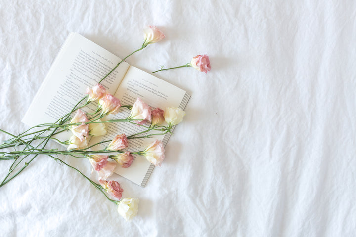 files/bed-with-book-and-flowers.jpg