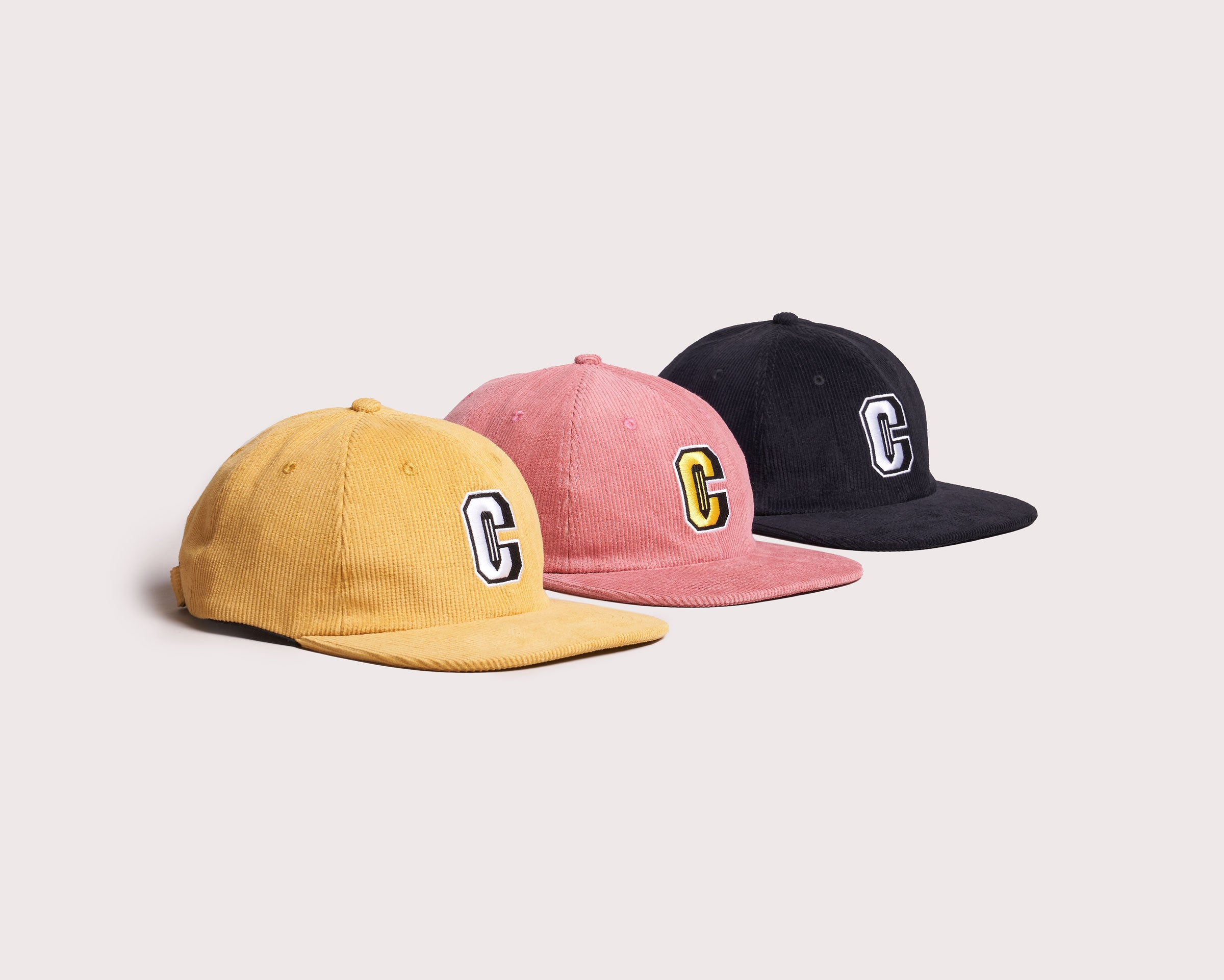 Three caps lined up together from a side view