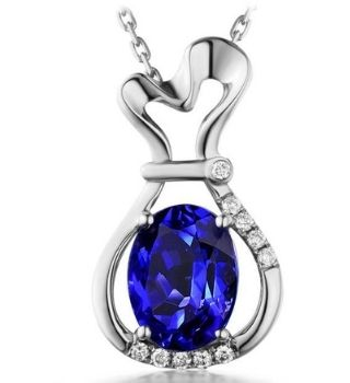 Image of 18k gold pendant with tanzanite stone