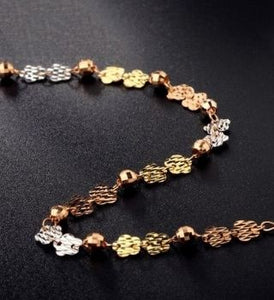 Gold bracelet with flowers and colored beads