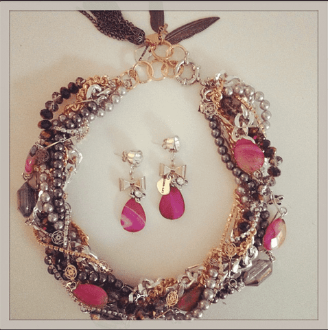 Multi strand necklace with pink agate stones and charms