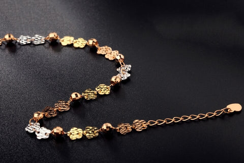 Image of Gold bracelet with flowers and colored beads