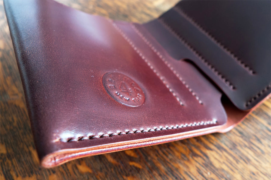 brujula new york hand stitched shell cordovan bi-fold wallet oil burgundy handmade in new york usa