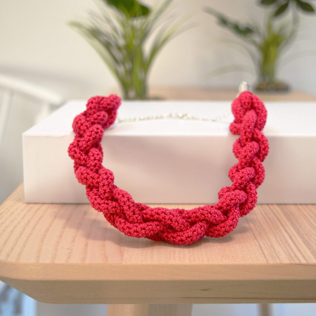 Red braided necklace completed from the braided necklace crochet kit