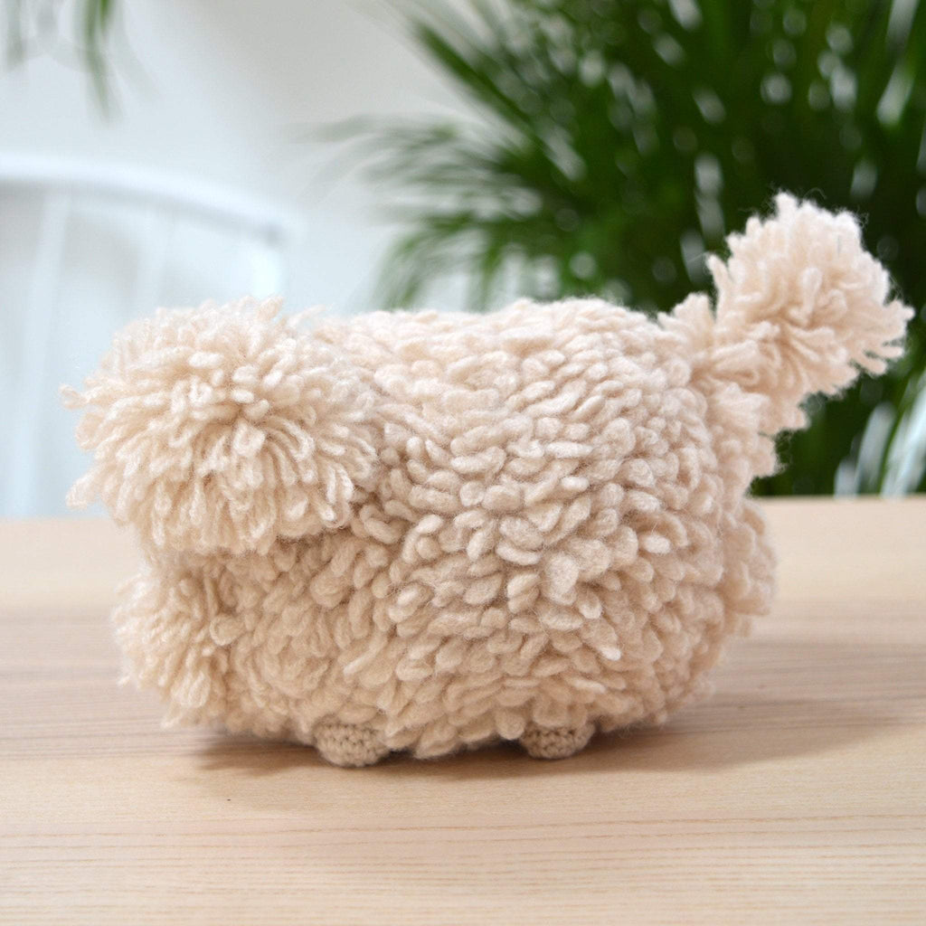 side view of completed amigurumi dog crochet kit