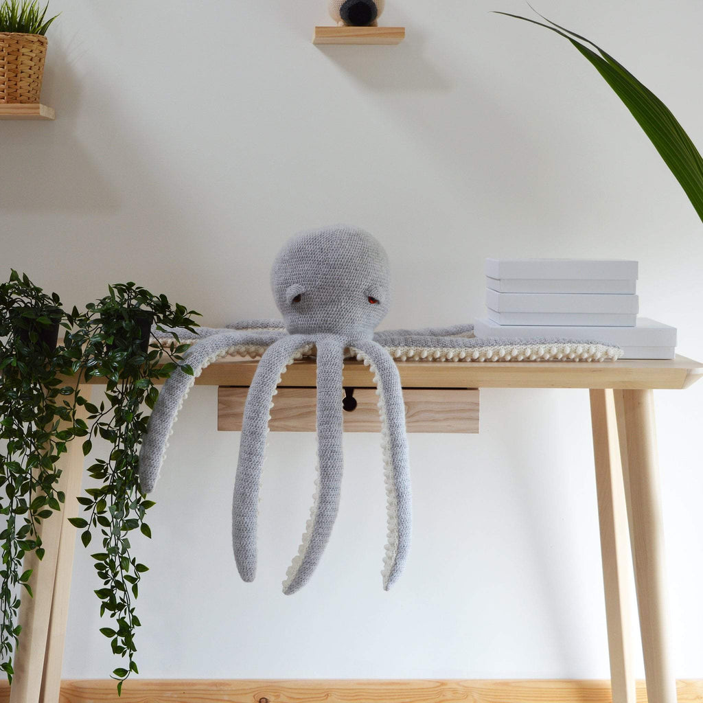 amigurumi octopus crochet kit on table in modern bright room with plants
