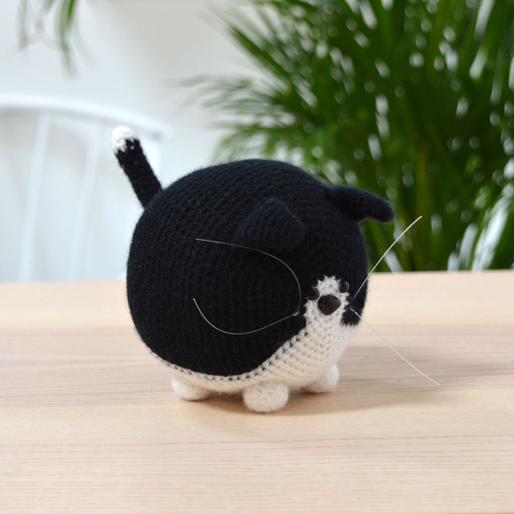 black and white crochet cat on table