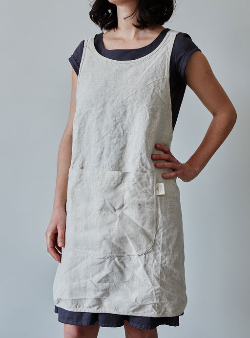 Front of our oat linen apron with a view of the pocket